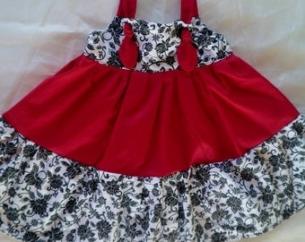 KNOT Dress in Red, White and Black. Available in sizes from 6 Mo. to 6T