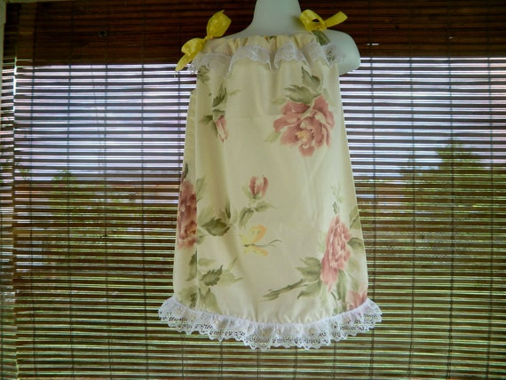 Pillowcase Dress in light yellow color, flowers and butterflies