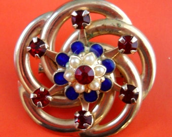 vintage faux ruby, lapis lazuli, and pearl gold atomic swirl flower brooch
