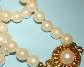 vintage strand of faux pearls with ornate floral clasp