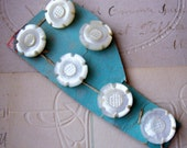Vintage carved pearl floral buttons on original card X 6