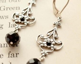 Aurélie.   Elegant Silver Daisy Earrings With Black Crystal