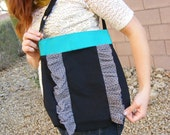 Black and teal ruffled front purse