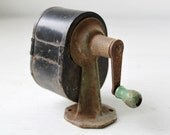 vintage 1920s pencil sharpener. Industrial chic. Spencer's Automatic. Green handle knob, black body. Wall or desktop mount.
