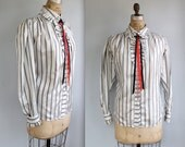 vintage 1970s striped blouse. Size 36. Country Western rockabilly style. Pearl snaps, ruffles and ribbon tie / the PEPPERY GRITS shirt