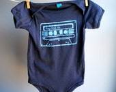 Baby Rock Mix Cassette Tape  Organic Bodysuit - Hand Dyed Charcoal Black and Screen Printed in Blue Ink, sized 18 - 24 months