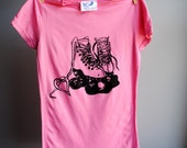 Roller Skates T-Shirt, Fitted, Hand Dyed Candy Pink and screen printed with Black ink.  Women's size small