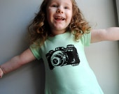 Camera T-Shirt Dress,  Hand Dyed Minty Aqua Green and screen printed in Black ink. Size 10