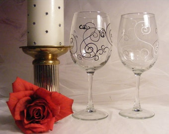 painted wine glasses one black swirls and one white swirls are elegant wedding gift for bride and groom