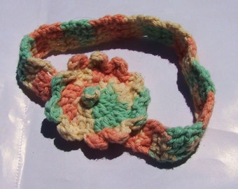Crocheted Baby Headband with 2 inch Multicolored Flower Variegated yarn pale pink to pale blue