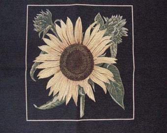 Sunflower yellow black upholstery fabric panel.