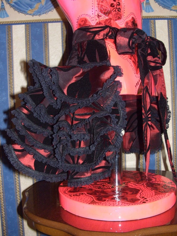 Victorian style burlesque ruffle bustle in wine red with black velvet print.