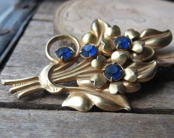 antique blue rhinestone bouquet - dark blue rhinestones on brass gold tone brooch