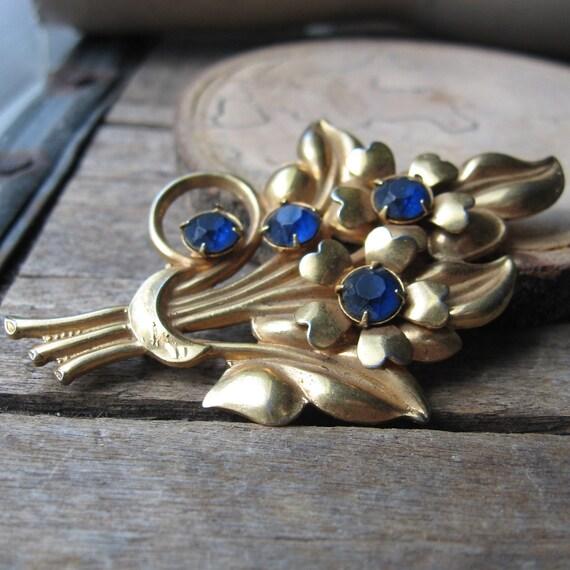 antique blue rhinestone bouquet - dark blue rhinestones on brass gold tone brooch