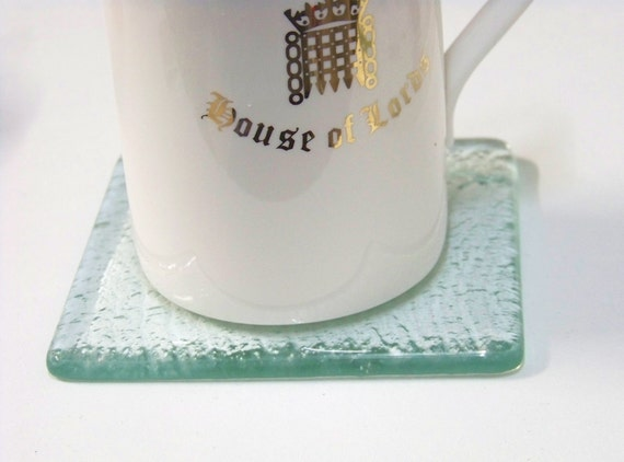 Set of 4 Coasters in elegant clear glass 10cm by 10cms available in other multiples
