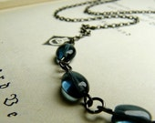Reserved for wilmotj-  A drop of ink - Montana blue glass and gunmetal necklace