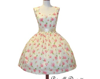 Summer Sale Rosettes dress made in new fabrics.