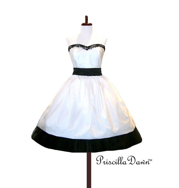 Black and White alternative wedding gown with neck ties and tulle sash.