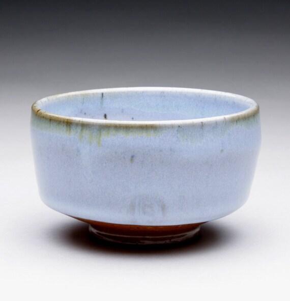 chawan tea bowl with soft light blue and orange shino glazes