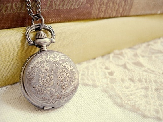 keeping time  - a antique pewter pocket watch necklace.