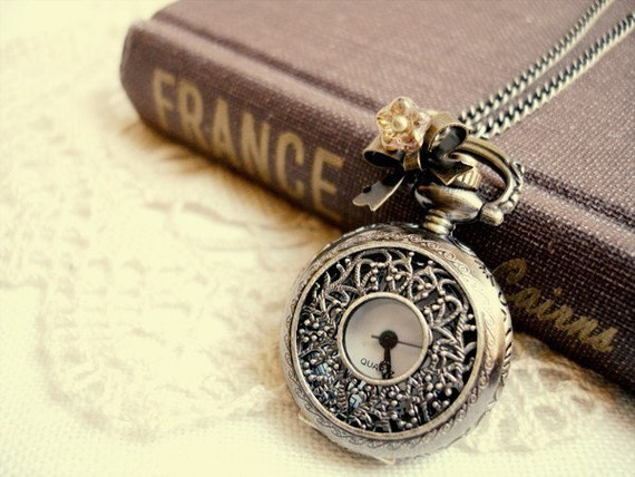 time standing still - beautiful intricate filigree pocket watch necklace.