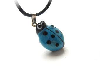 Blue Ladybug Evil Eye Pendant
