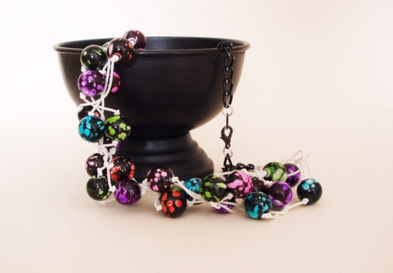 No. 109 Paint splattered beads on rubber cord...
