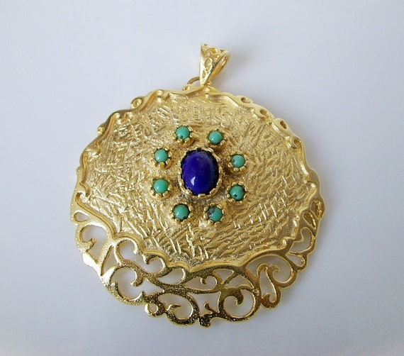 Gold plated medallion with blue and dark blue