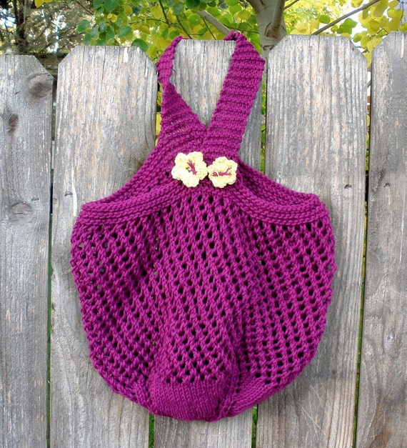 Purple Knitted Market Tote with flowers on handle.