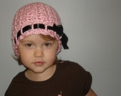 Pink toddler crochet hat with satin ribbon