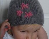 Fuzzy baby beanie grey with pink flowers