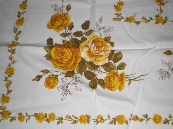 A tablecloth full of yellow roses. Vintage home decor. Linens.