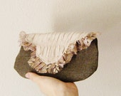 Rylie at the Taj Mahal... Beige and brown clutch w/ mauve gold lace ruffle