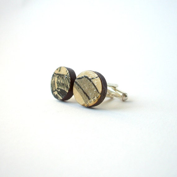 Cufflinks made with antique French newspaper