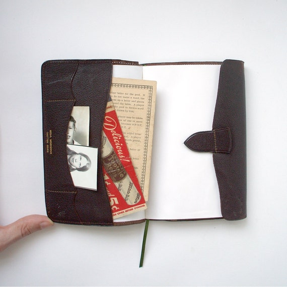Handmade book with pockets. Bound in vintage leather wallet.
