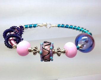 Pink and Purple Spiral Art Glass Wire Wrapped Bracelet