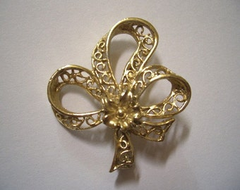 Vintage Shamrock Trefoil Ribbon Sweetheart Pin gold tone... Peggy was the talk of the office. Moddities