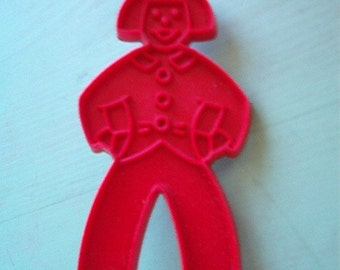 Retro Tupperware Red Hard Plastic Man or Woman Figural Cookie Cutter