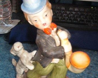 Vintage Porcelain Boy and Dog with Musical Instrument Figurine