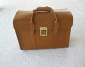 Vintage brown leather satchel valise. briefcase. carry on bag