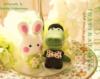 alligator and rabbit wedding cake topper