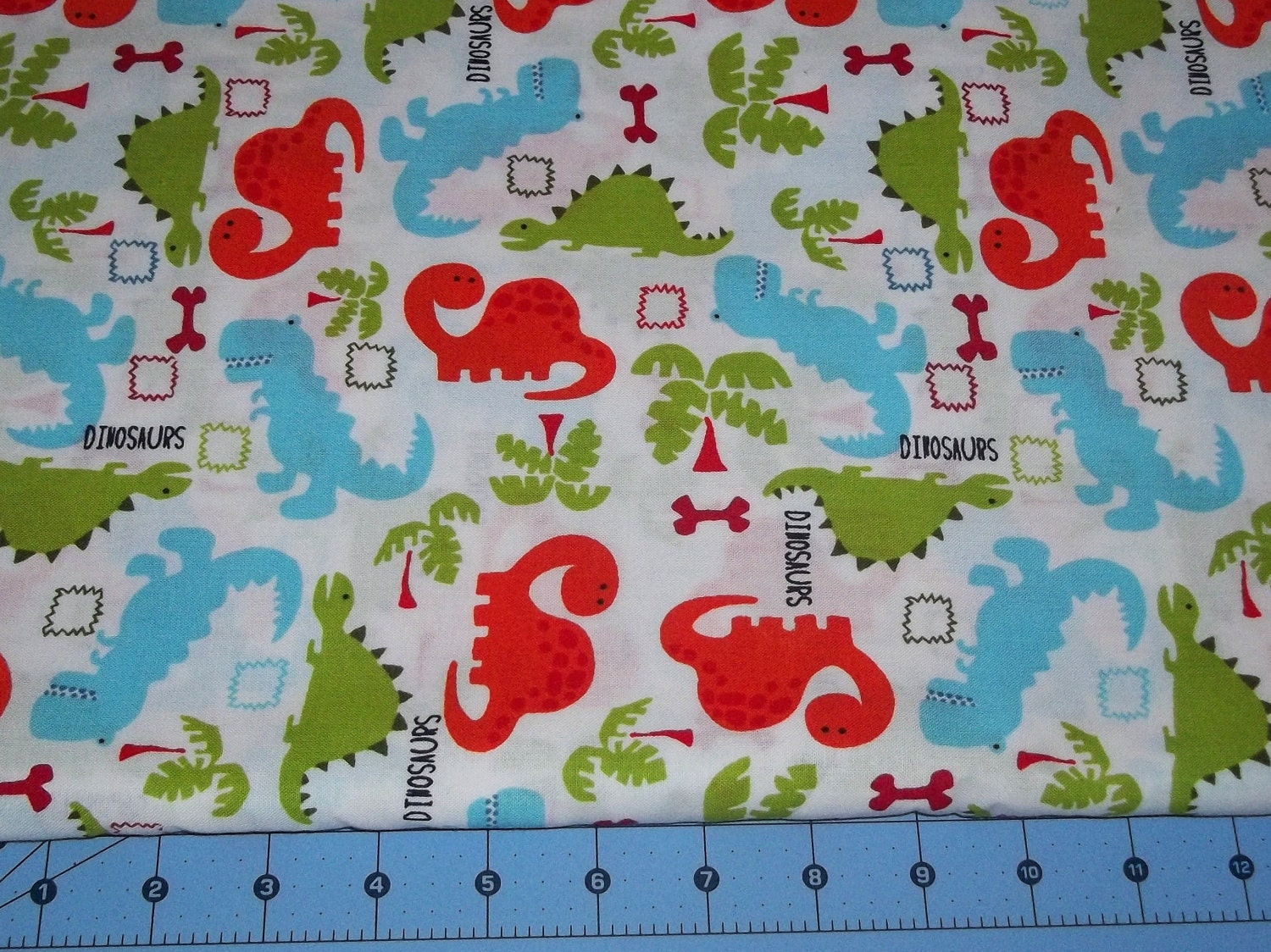 Dinosaur fabric by the half yard for Dinosaur fabric