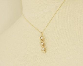 golden pea pod necklace