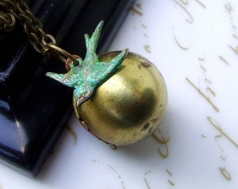 Brass vintage round ball locket and soaring sparrow necklace, flying vertigris bird, small locket
