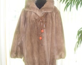 Luxurious vintage 50s  faux fur  beige coat, accented with rope. Made by Grandella II .  Size 20