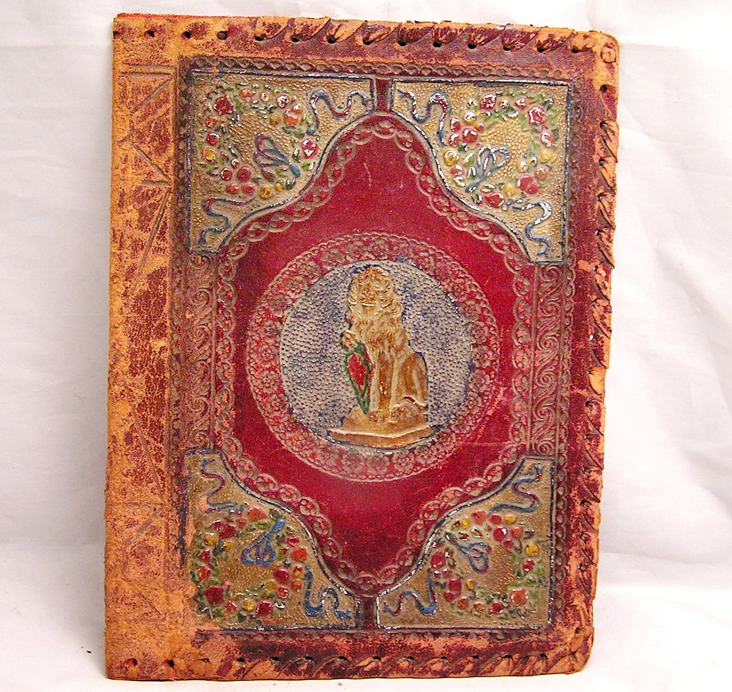 Vintage Leather Book Cover : Antique embossed leather book cover with lion