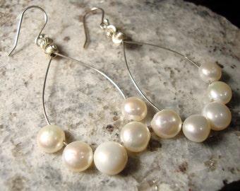 White fresh water pearls on sterling silver earring hoops