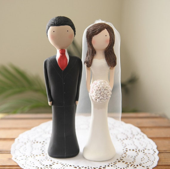Custom Designed And Hand Sculpted Wedding Cake Toppers