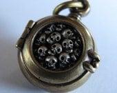 steampunk mourning locket  SKULL LOCKET bronze with sterling silver skulls