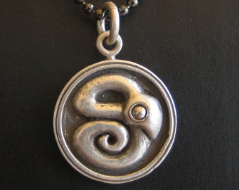 SERPENT DISC sterling silver and stainless steel on long gunmetal ball chain